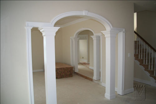Elliptical arches with adams casings, keystone details & added square plain columns
