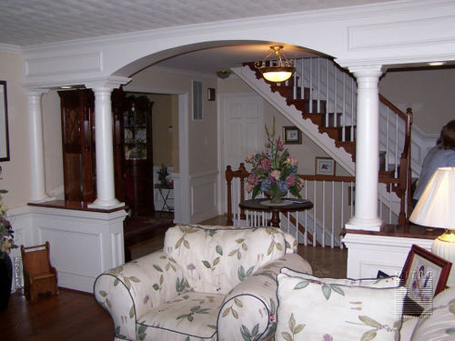 Foyer custom arched 1/2 walls with granite counters