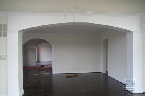 Large custom opening with plain square columns and a five piece crown with double keystone feature