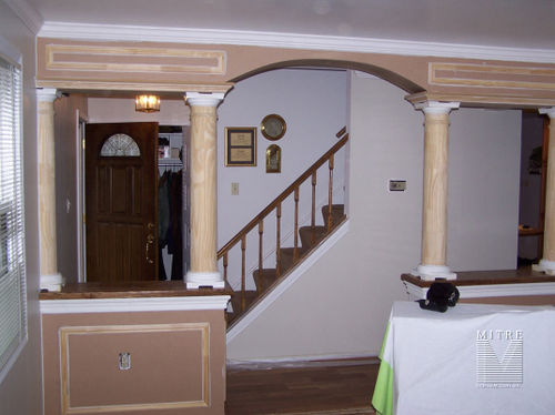 Foyer 1/2 walls and archway with round tapered columns and stained oak capboards
