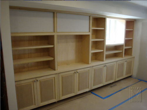 New Built-In Bookcases with TV space, adjustable shelves and raised panel doors