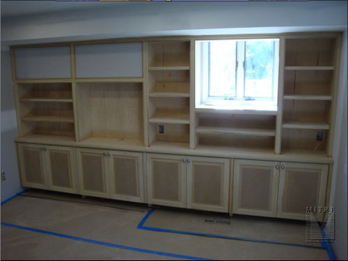 Birch veneer plywood construction with solid wood facings make up these built-in cabinets