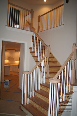 Oak rails & newels, with primed balusters