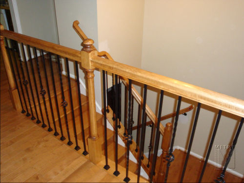 Maple rails & newel post with metal balusters