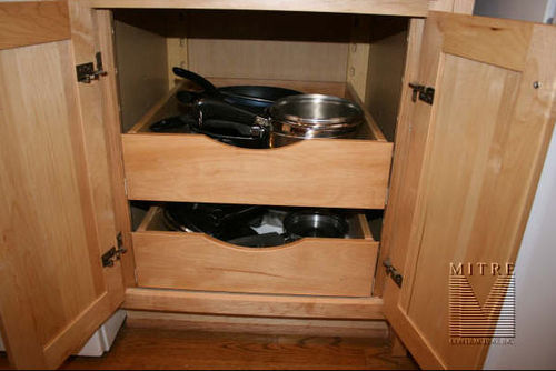 Roll out trays in base cabinetry