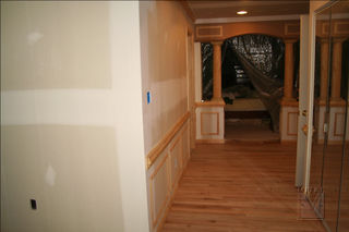 Entrance oak hardwood flooring, archway, crowm moulding & wainscoting