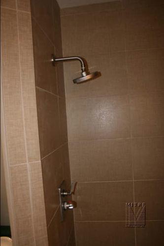 new shower tile & upgrade plumbing fixture