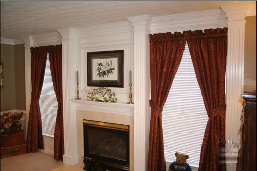 Fireplace surround with fluted pilasters & 3 piece crown mouldings