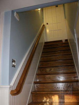 Wainscot Beadboard in stairway with oak railing