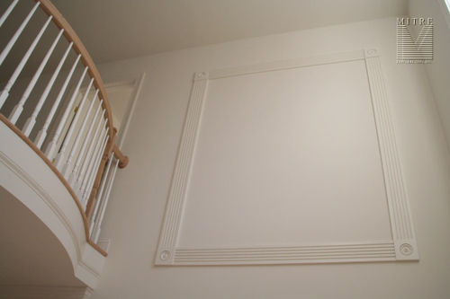 "Single wall panel treatment utilizng 5"" fluted casing and rosette corners"