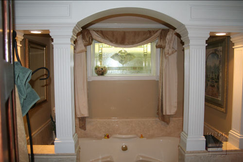 Archway & halfwalls with fluted square columns, in a bathroom renovation