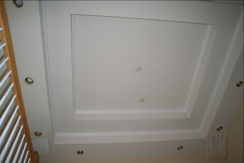 Double tray ceiling in stairway with crown moulding