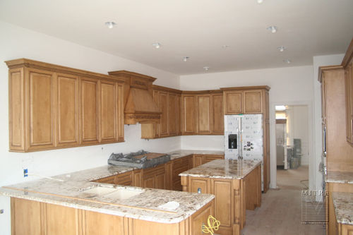 Kitchen with custom cabinetry and granite tops