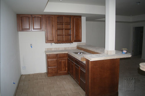 wet Bar with Cherry Cabinets & ceramic tile counters