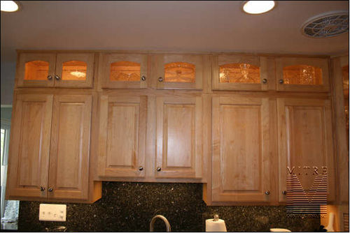 Double stack of wall cabinets with interior lighting accent