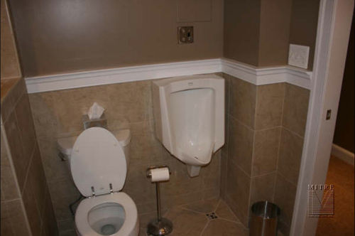 Bathroom renovation, homeowner opted to go with a urinal with motion sensor flush