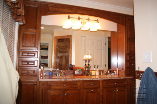 Double sink vanities with granite counters & HAAS brand cabinetry