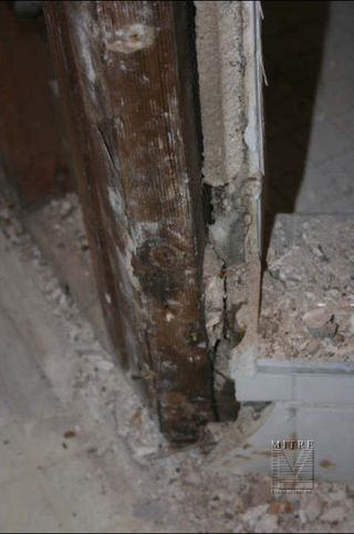 bathroom remodel - before picture showing rotted wood at shower
