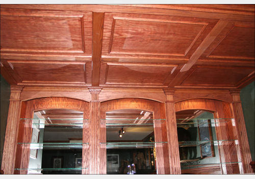 Oak Ceiling Treatment in wet bar area with removable panels for plumbing access