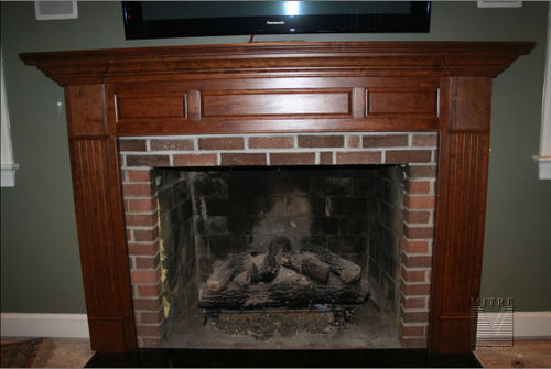 Cherry mantel with raised panels and fluted legs