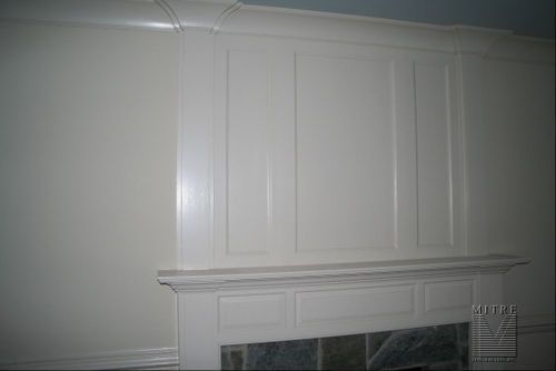 Raised panel mantel with recessed panels and crown over
