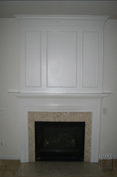 Mantel with decorative over mantel feature mouldings