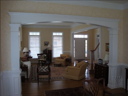 Custom Arched Cased Opening with Fluted and Paneled Columns