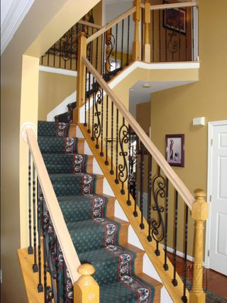 Oak Railings showing new forged iron balusters with twists & scrolls