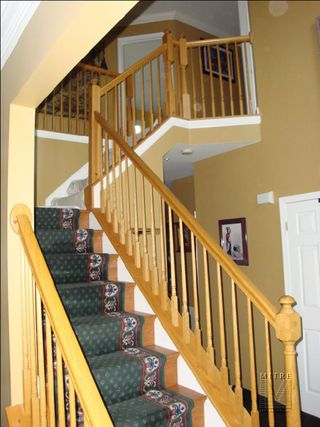 Oak stair railings before baluster replacement