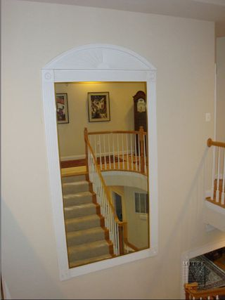 Fluted Wall Panel in stairway with mirror insert and sunburst feature