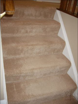 Carpeted steps at the landing before makeover