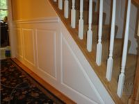 Raised panel wainscoting at rake rail in foyer