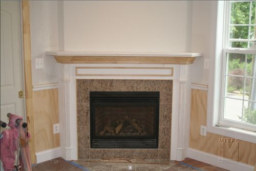 New mantel surround with pilasters,plinths, crown and applied panel
