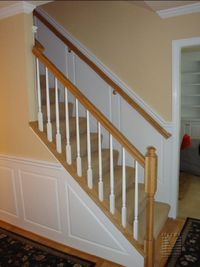 New oak railings, painted balusters, raised panel wainscoting, crown moulding