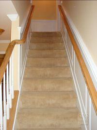 Stairway raised panel wainscoting and railwork