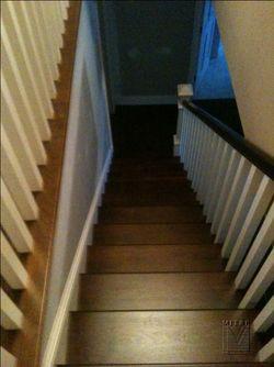 New walnut stairway, looking down