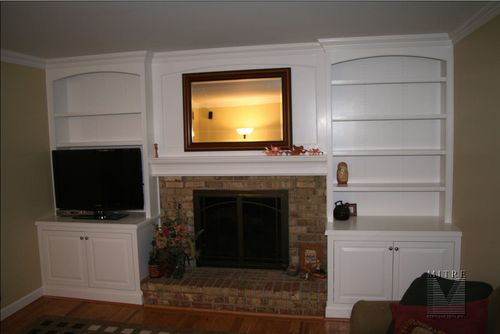 Built-in cabinetry around fireplace with arched valances