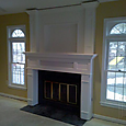 Mantel with overmantel and hidden storage