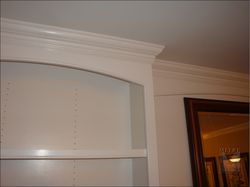 Close up view of the arched valance and cabinet beading detail