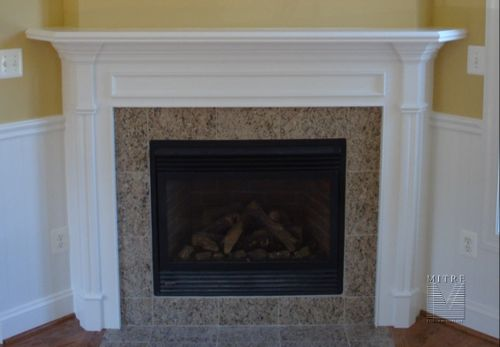Mantel feature made from stock mouldings