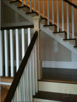Stairway after reframing, new treads and railings