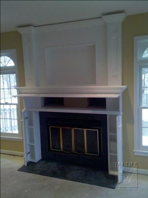 Mantel with hidden compartments opened