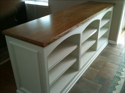 Built-In cabinetry with oak counter and arched valances