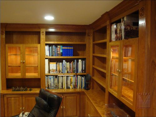 Built-Ins with lighted glass front display cabinets with glass shelving