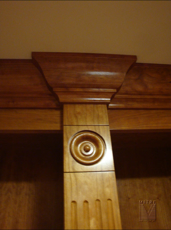 Fluted pilaster with rosette and crown moulding