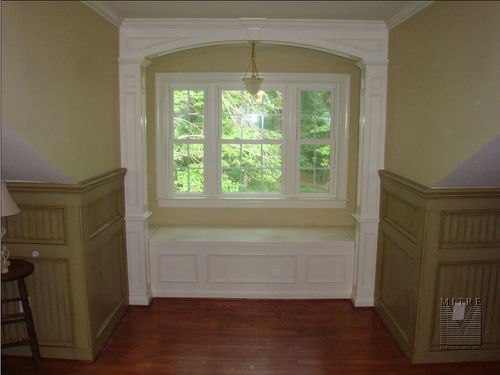 Window Seat Archway with a paneled beadboard wainscoting