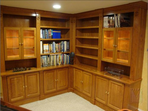 Custom cherry built-in cabinets with lighted glass display cases