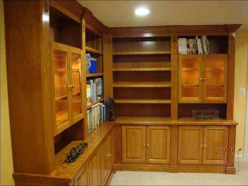 Cherry wood custom built-in cabinets for family room