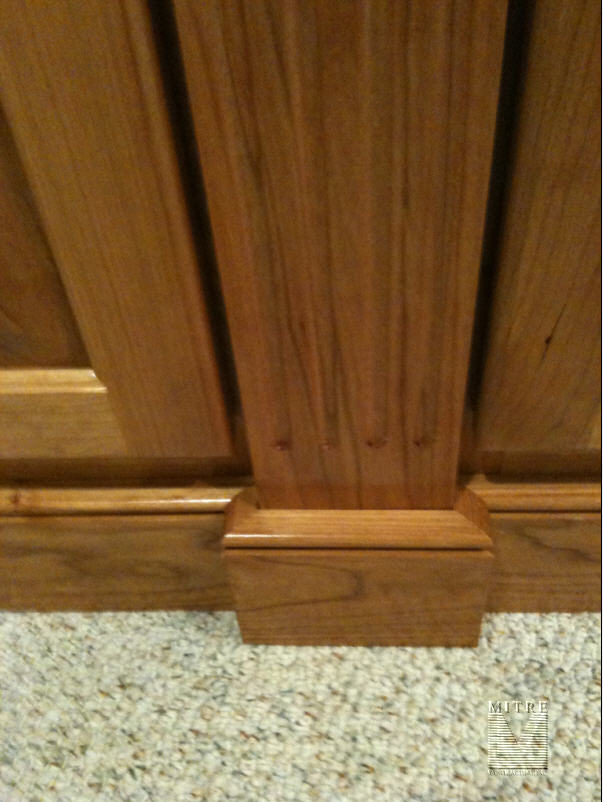 Built-In base cabinets... fluted pilaster and baseboards