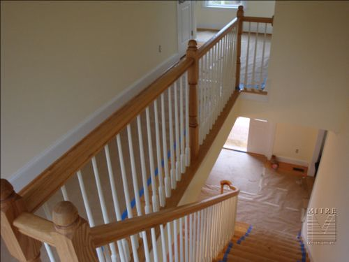 Upstairs view of the curved bannister